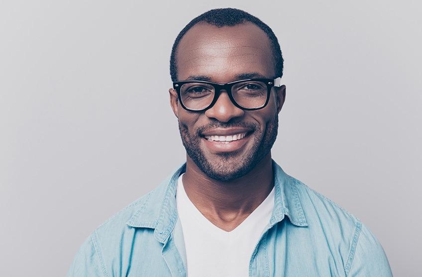 smiling man wearing glasses