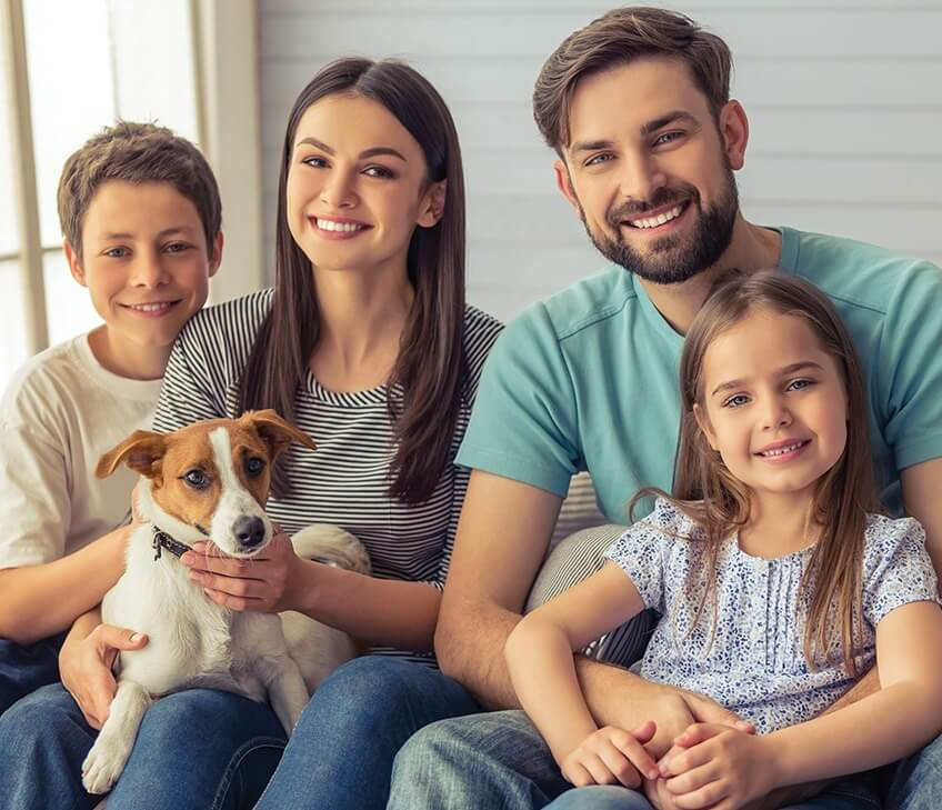 happy young family with their dog