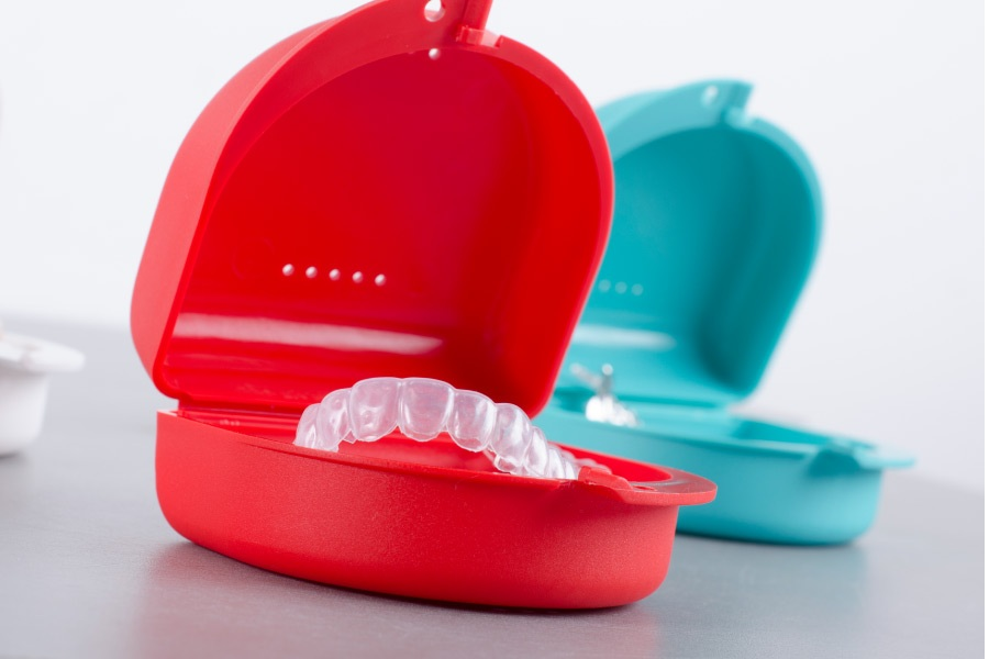 ClearCorrect clear aligners in colorful cases